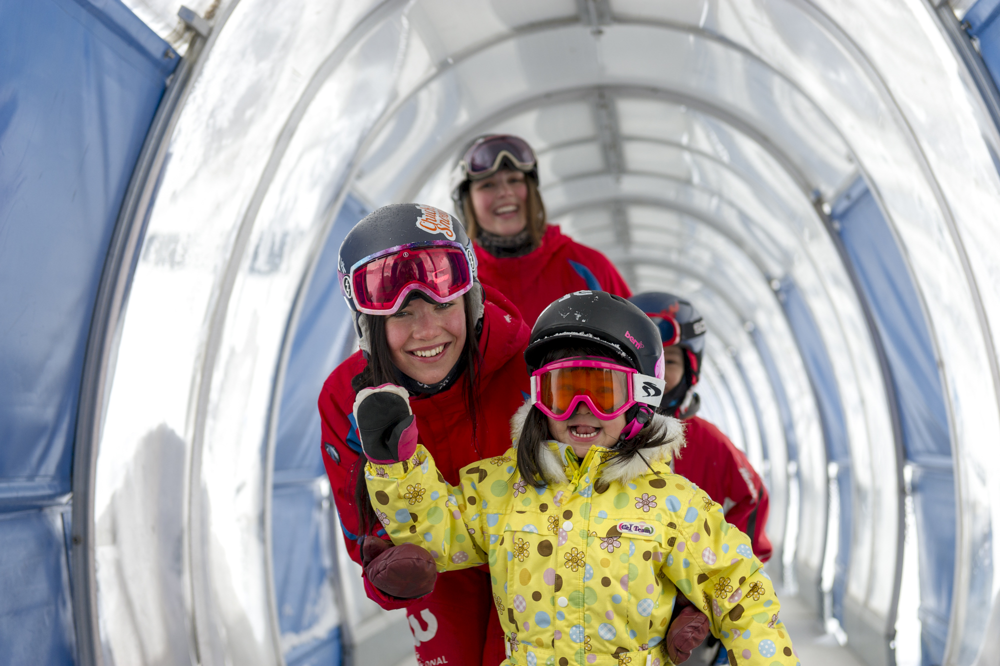 Children having fun with their ski instructors